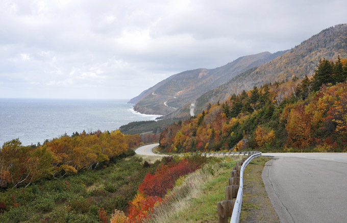 Cabot Trail in Nova Scotia in the fall with trees changing colours. National Parks of Canada | Skyscanner Canada
