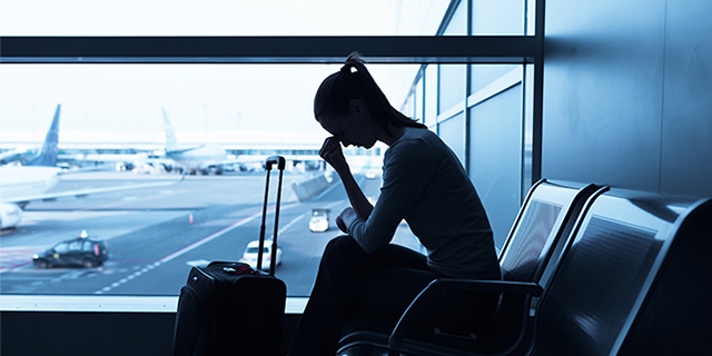 Woman frustrated for her delayed flight at the airport