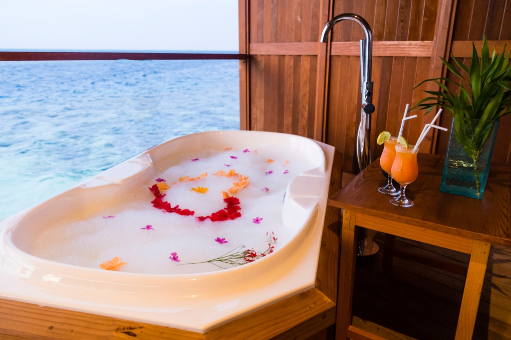 a bath looking over the ocean in the Maldives