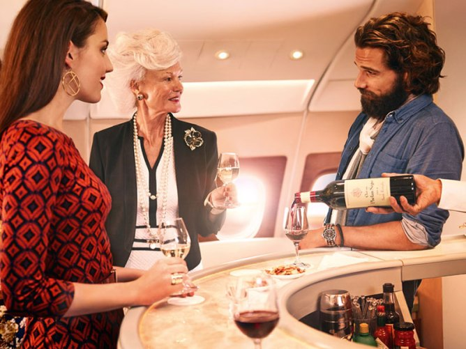 passengers around a stand-up bar in business class