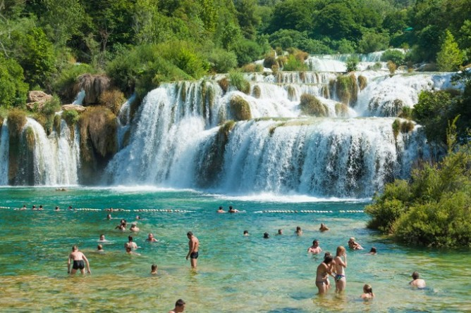 People swimming in Krka National Park, Croatia