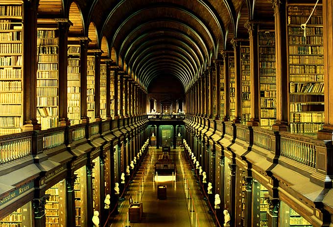 Rows of books in Trinity College's Old Library, where the Book of Kells is held - one of the most spectacular filming locations in Ireland