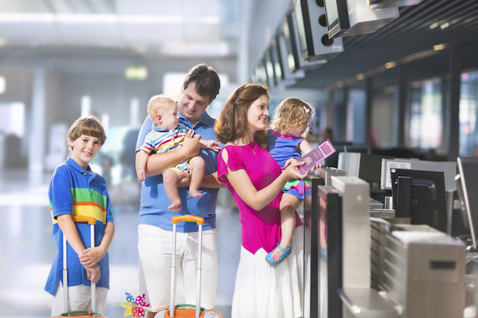 Parents flying with children check in at the airport