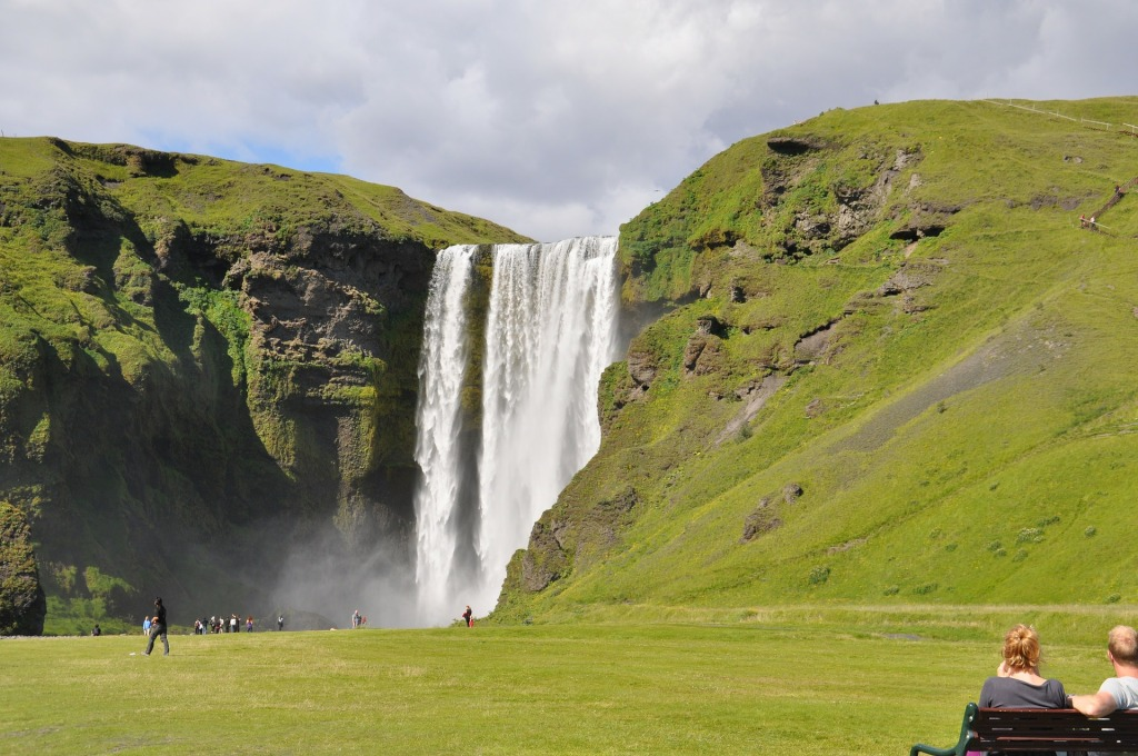 Image of a giant waterfall in Iceland, which is a Top Summer European Vacation. Splurget in Iceland | Skyscanner Canada