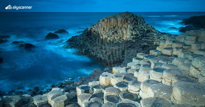 Giant's Causeway's interlocking basalt columns flanked by the Atlantic Ocean