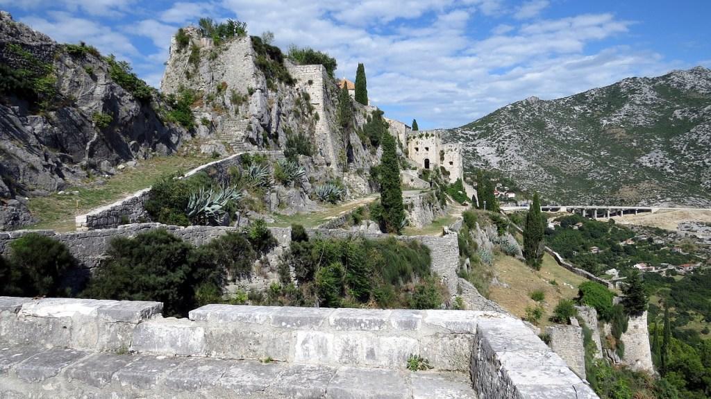The medieval Klis Fortress sits atop a hill near Spilt, Croatia