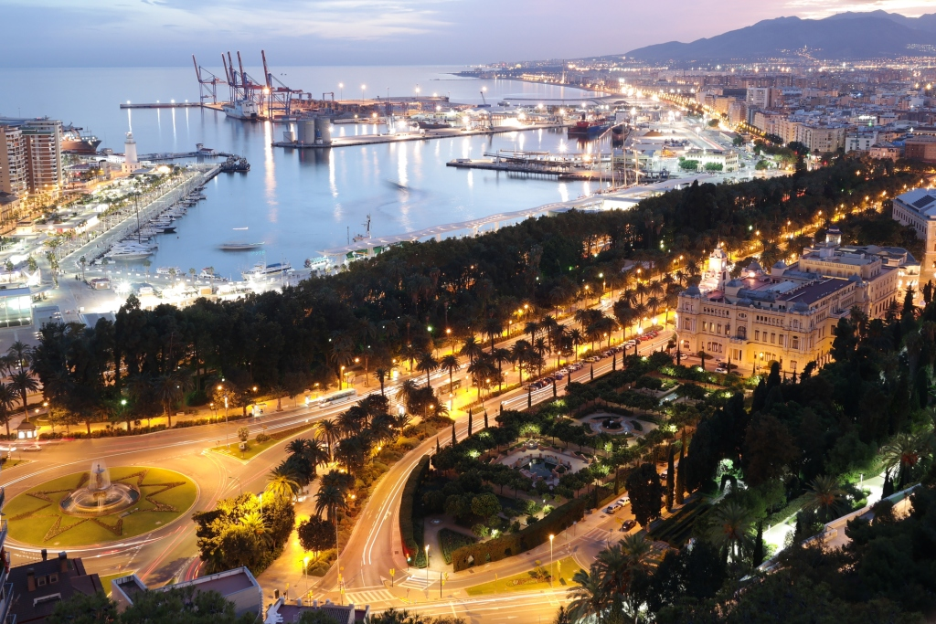 The port of Malaga lit up at sunset