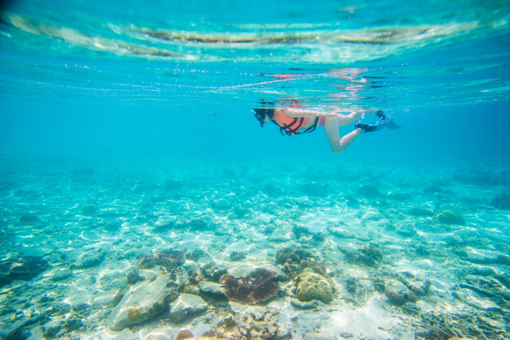 girl snorkelling in clear water