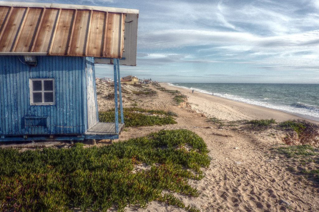 A blue shed overlooking Praia de Faro, Algarve, Portugal
