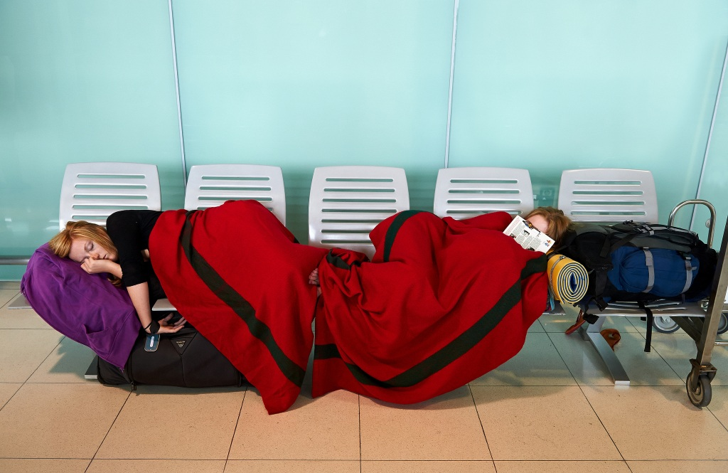 travellers sleeping in an airport