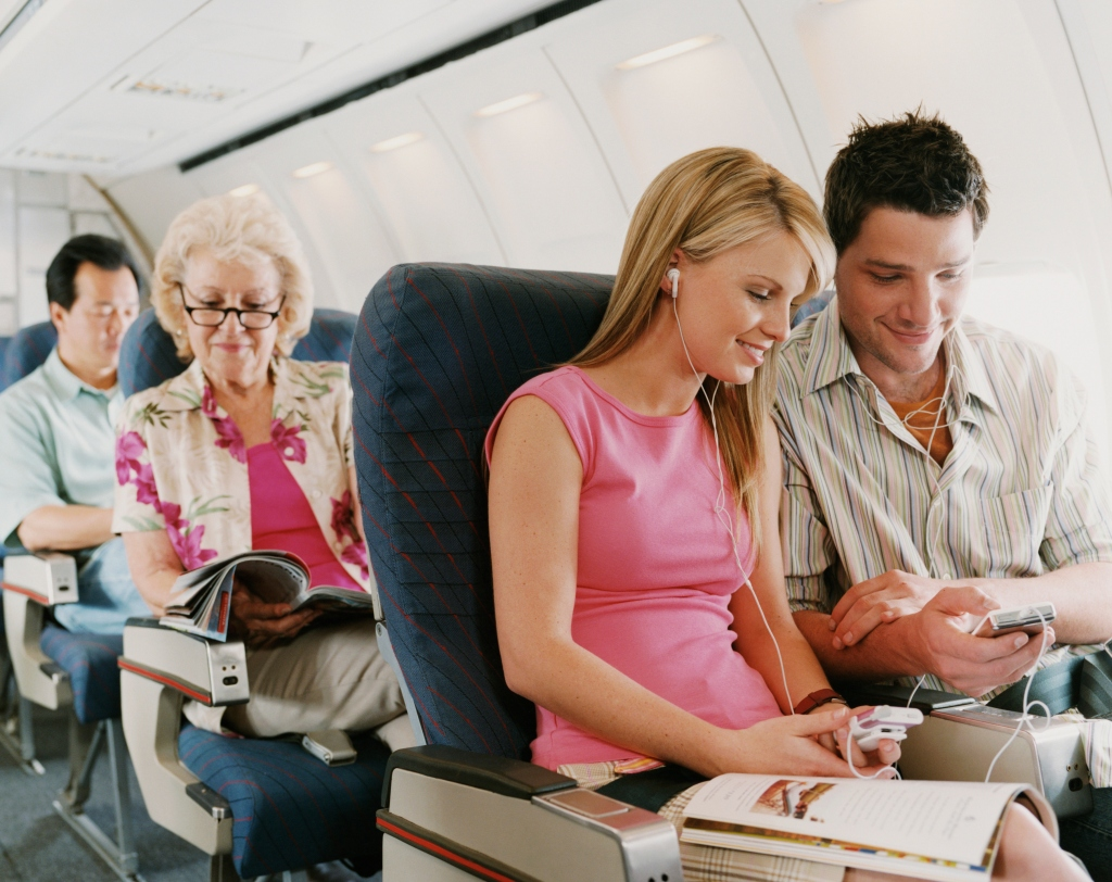 Passengers on flight looking relaxed and happy
