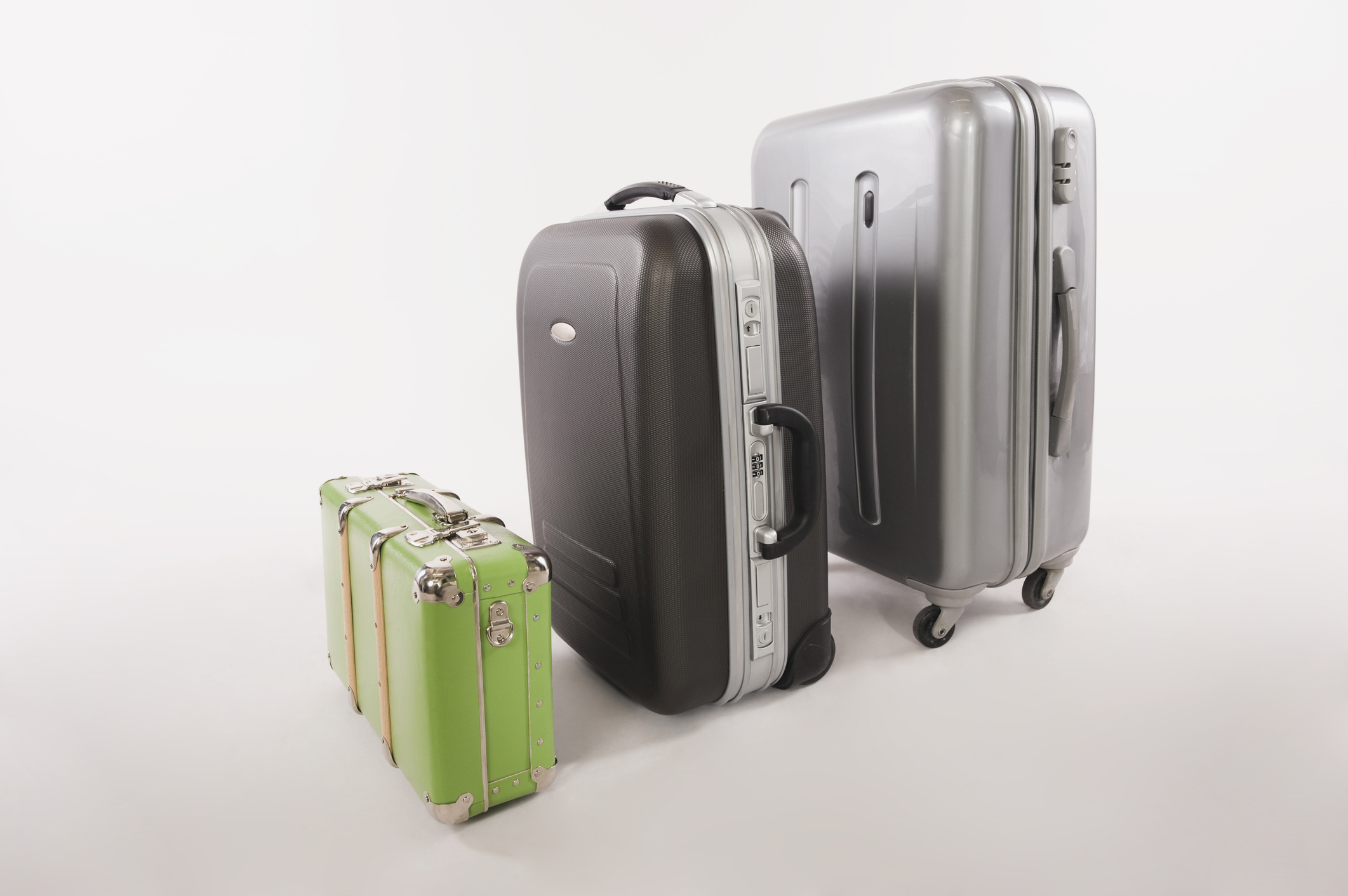 Three suitcases of varying sizes. Checked Luggage and Carry-on Baggage Rules   Skyscanner Canada