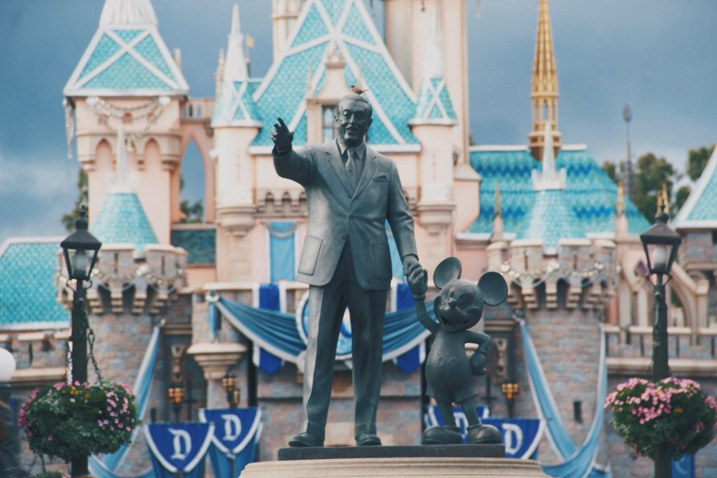 Statue of Walt Disney and Mickey Mouse at the Entrance of Disneyland in California.