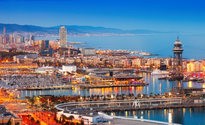 View of the Barcelona port at sunset. Top Summer European Vacations: Barcelona | Skyscanner Canada
