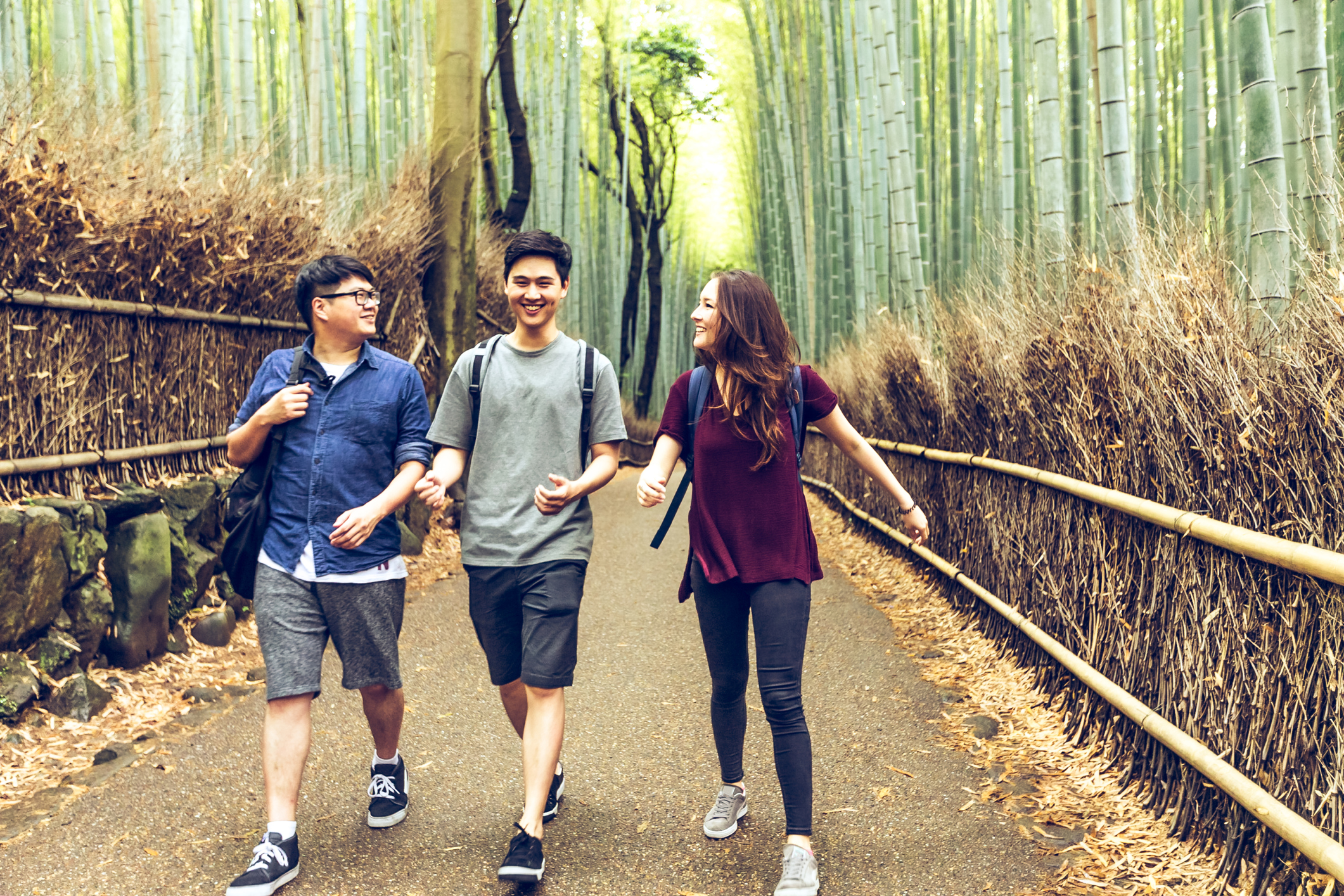 College Students taking a hiking trip to Bamboo Forest in Arashiyama, Kyoto, Japan