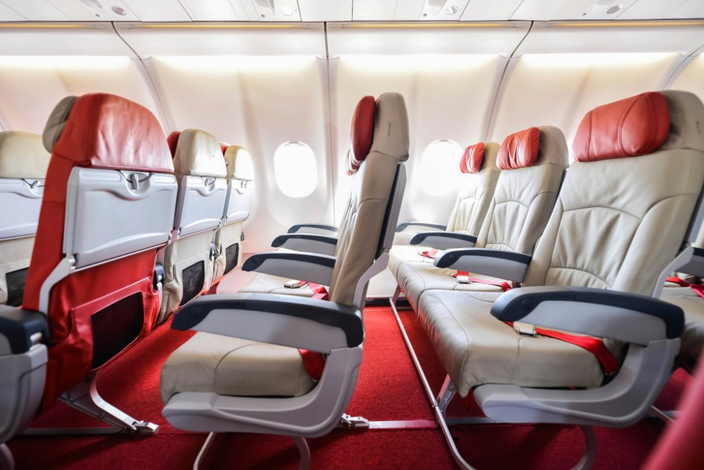 Rows of seats on an airplane. Expedia Flight Deals | Skyscanner Canada
