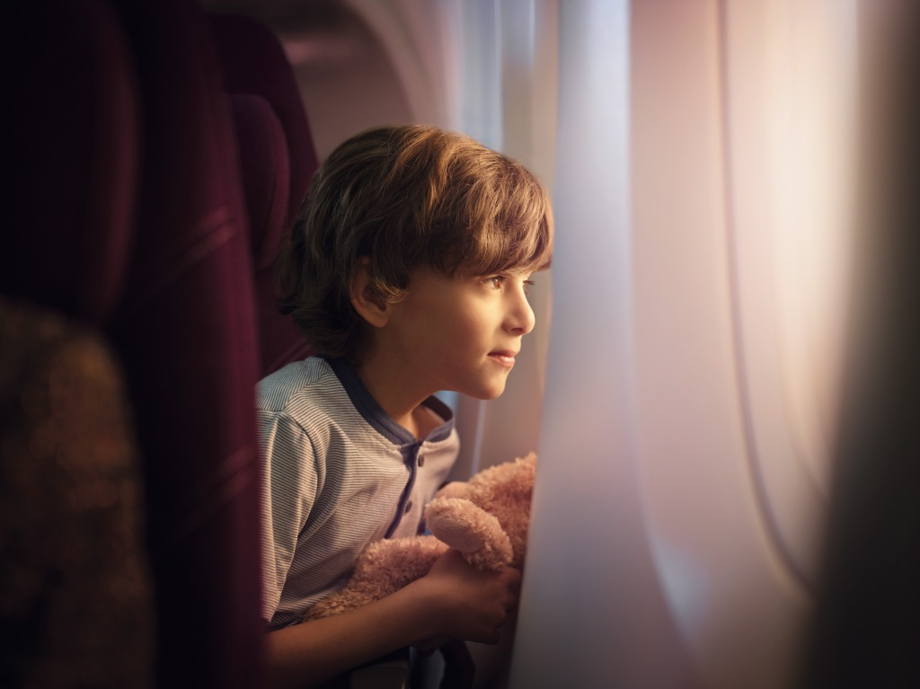 A young child on a plane
