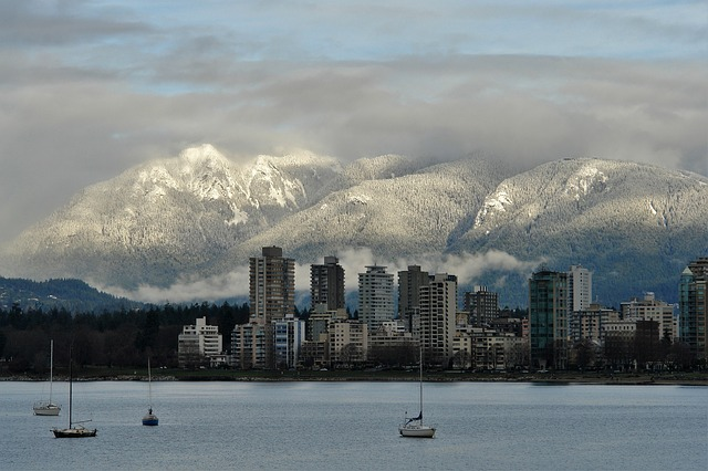 view of vancouver from the north shore with snowy moutains. things to do in Vancouver