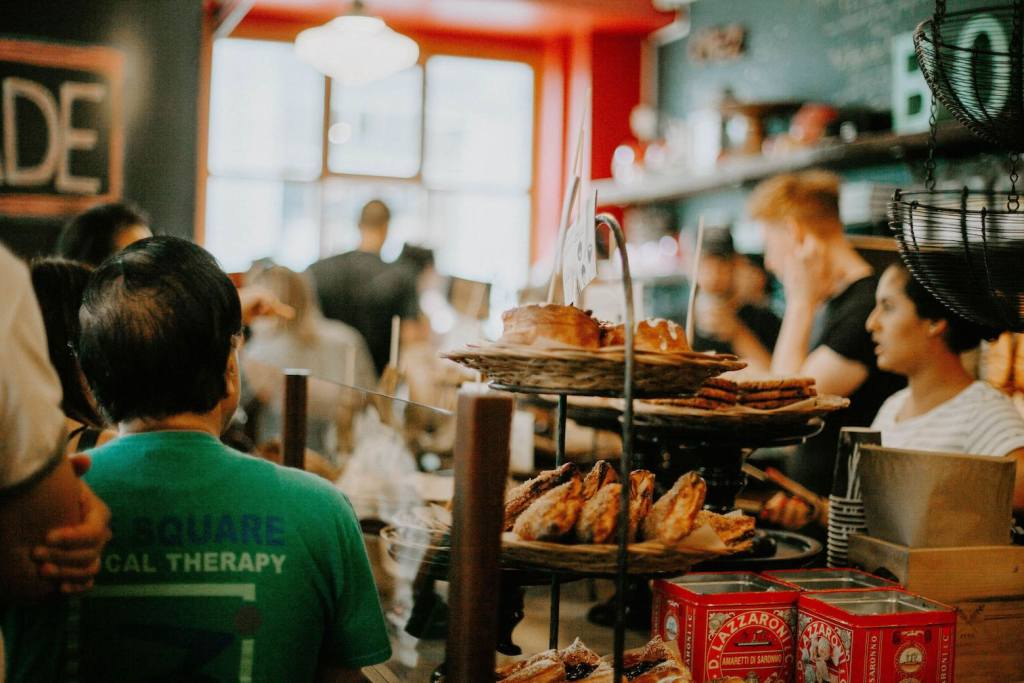 inside of a bustling coffee shop in Montreal with pastries