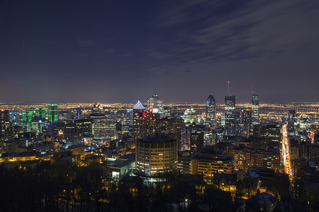 View of Montreal at night from Mount Royal. Hiking Mount Royal is one of the top things to do in Montreal