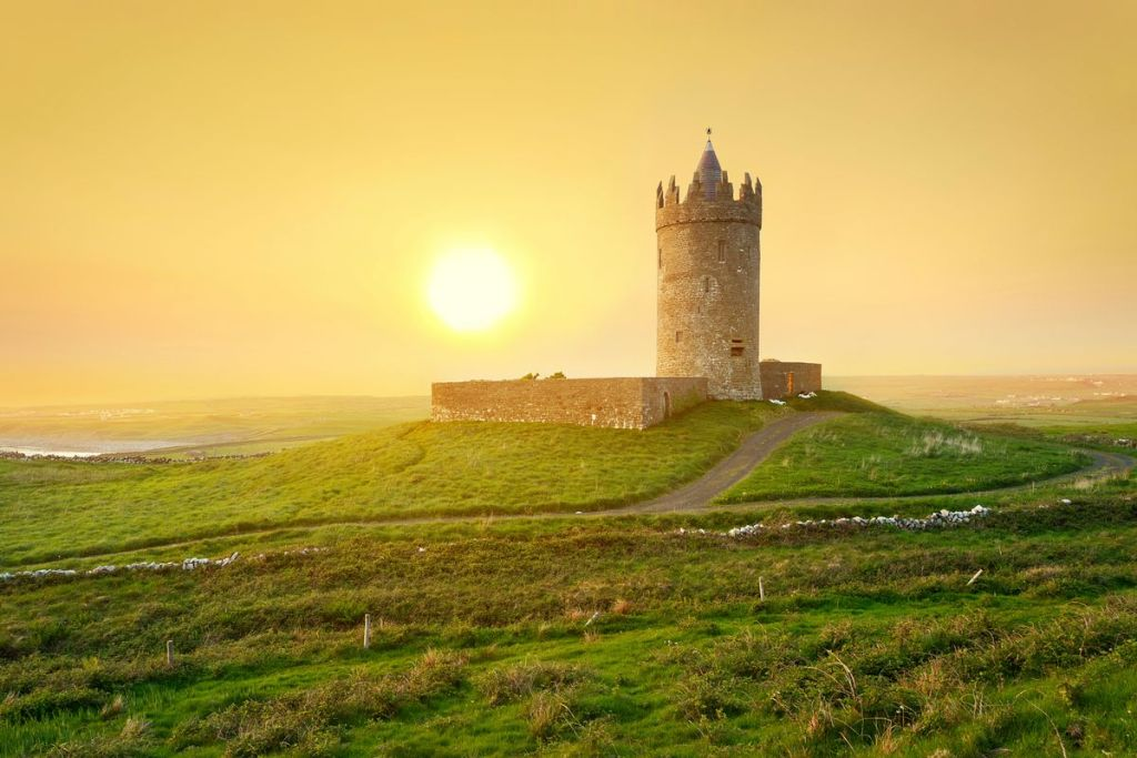 Doonagore Castle, County Clare, Ireland in the sunset