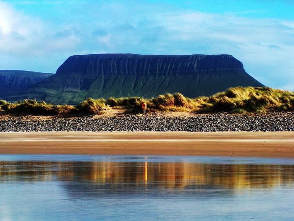 The shape of Benbulben Mountain in the distance, as seen from a lake in County Sligo, Ireland