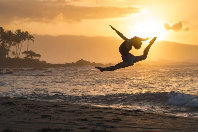 Girl flexing on the beach