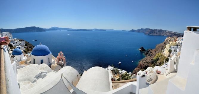 View from Oia, Santorini - last minute flight deals to greek islands